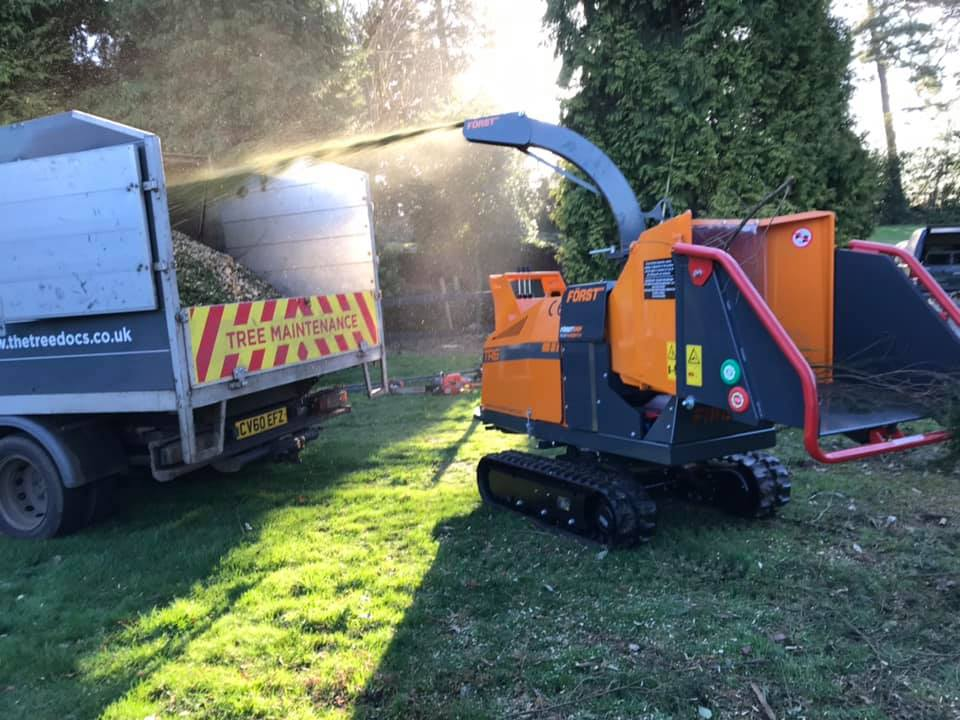 Wood Chippings being sprayed into tree maintenance pick up