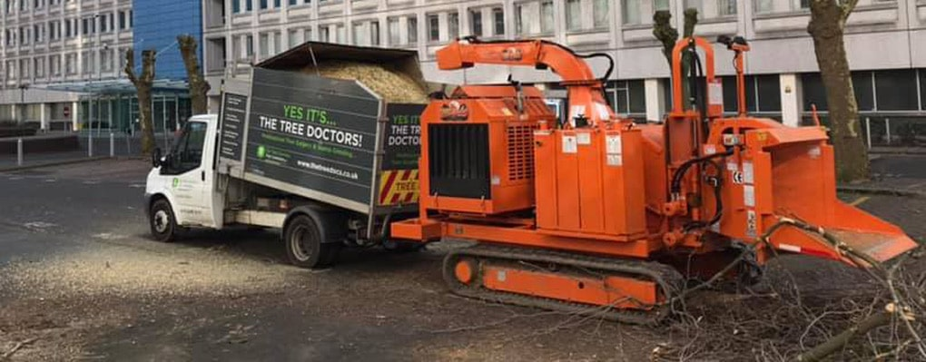 tree doctors van collecting cuttings from orange machine