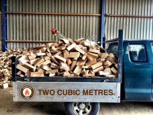 Fire Logs for sale. firewood on the back of blue van