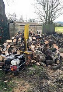 Fire log splitting. pile of firewood