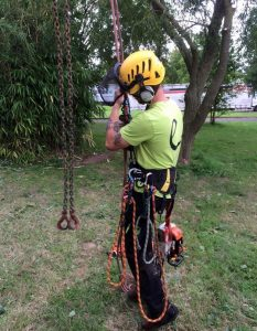 surgeon on harness - standing on ground ready to go up